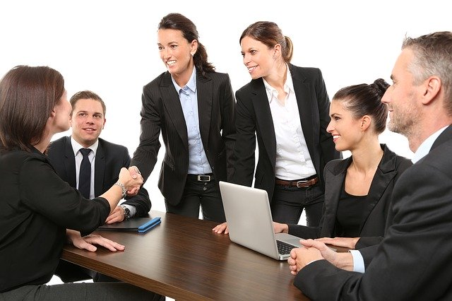 Stock image of business women, with hair in pony tails and buns.